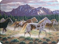 Horses Running against beautiful Mountain Cutting Board