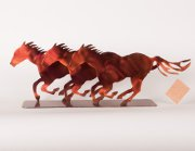 """Running Horses"" 3 Small Steel Horses on a stand in Orange"
